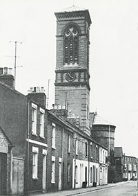 Fig. 1:   The campanile of St. Barnabas rises above typical Jericho houses. This Italianate tower was built in 1872, and re-roofed in 1893.