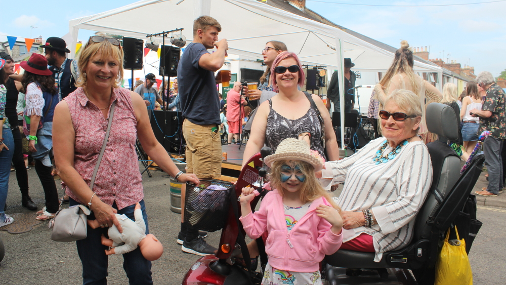 Three generations enjoy a day at the Fair. Left to right: Delia Redding, Theresa Pullin, and Pat Rooney whose grand-daughter is in front with the fetching eye make-up.